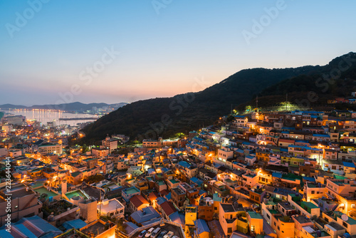 Gamcheon Culture Village formed by houses built in staircase-fashion on the foothills of a coastal mountain at night in Busan, South Korea.