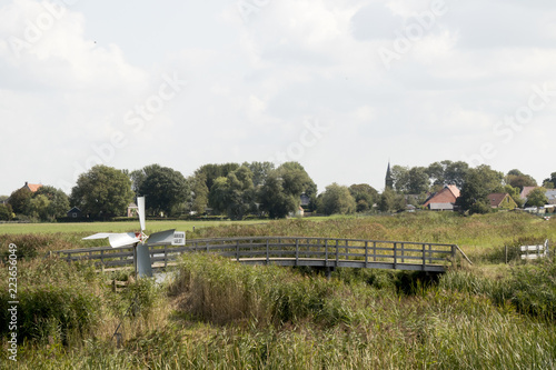 Foto  Historical watermill in the meadow