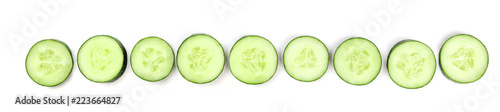 Cucumber slices forming a line on a white background with a place for text