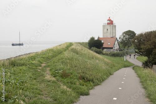 Foto  Historical light house De Ven in Oosterdijk