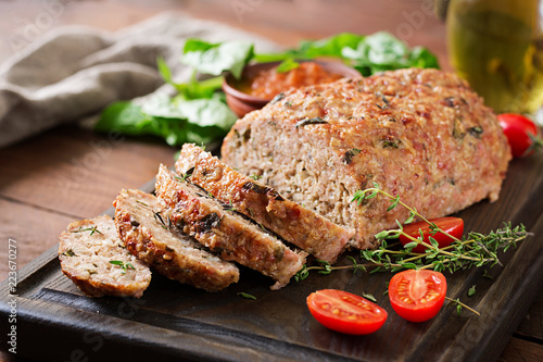 Tasty homemade ground  baked turkey meatloaf on wooden table Canvas Print