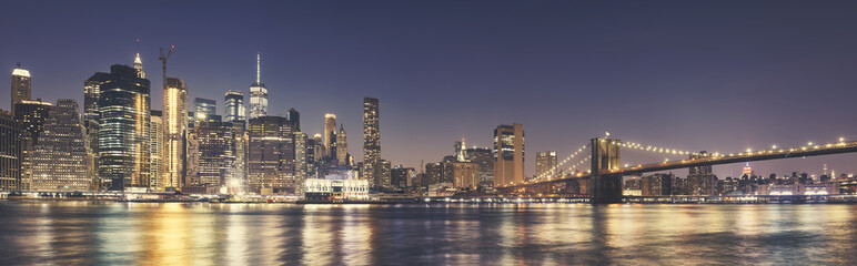 Fototapeta Manhattan skyline an the Brooklyn Bridge at night, color toning applied, USA.