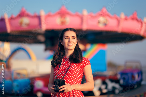 Girl in Retro Outfit with Vintage Camera at Carnival Fair