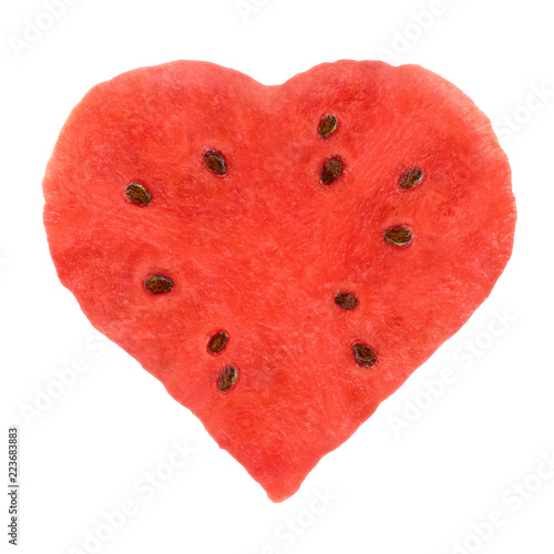 Juicy pulp watermelon in shape of heart on white background