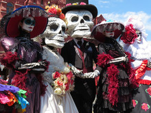 Day Of The Dead. People In Death Masks And Skeleton Costumes During Traditional Mexican Holiday Dia De Los Muertos