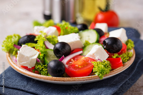 Traditional Greek salad with feta, olives and vegetables