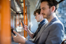 Commuter Using Smartphone On T...