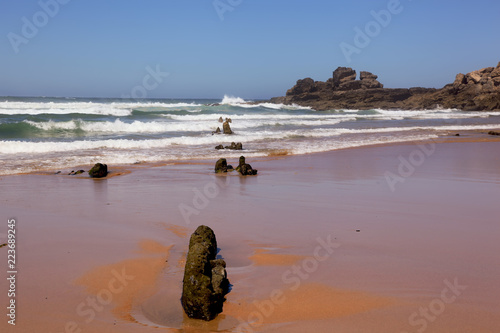 Fotografia  Portugal Ursa Beach at atlantic coast of Atlantic Ocean with rocks and foam at sand of coastline picturesque landscape panorama