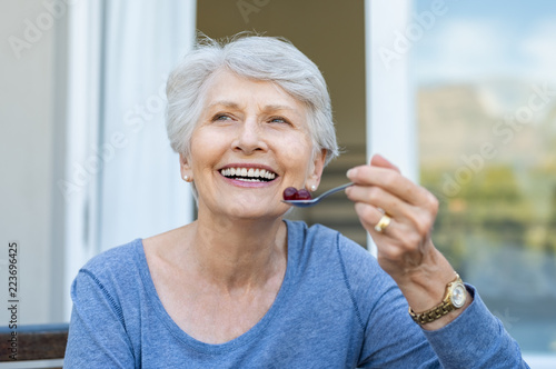 Senior woman eating fruit
