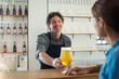 canvas print picture Bartender serving beer to woman
