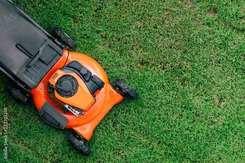 Lawn mowers cut grass. Garden work concept background