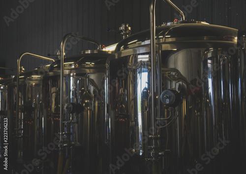 Foto auf Gartenposter Bier / Apfelwein Stainless tanks for fermentation in a beer brewery.