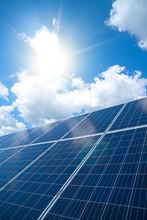 Blue Solar Panels Over Blue Sk...