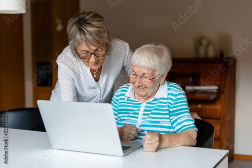 Very old senior woman learning to use a computer