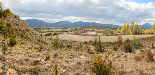 Foto op Plexiglas Zandwoestijn Blue cloudy sky and typical mountains and hills covered with forest met in autumn while hiking from the small Yebra de Basa town to Santa Orosia church on the Pyrenees mountains, Aragon, Spain