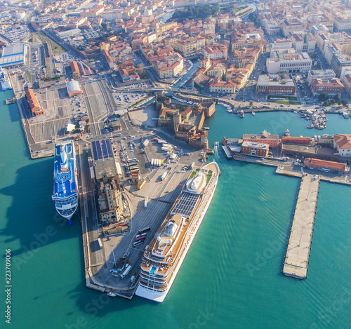 Large ocean liners are moored in the seaport of Livorno, Italy
