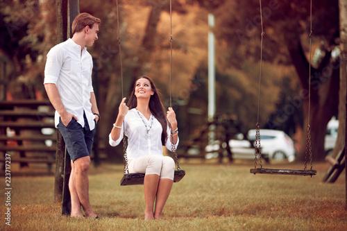 couple having fun in the park autumn