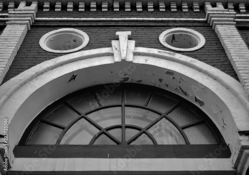 Foto op Canvas Theater East Kazakhstan Drama Theater. Kazakhstan (Ust-Kamenogorsk). Black and white photo. Fragment. Old architecture. Architectural heritage