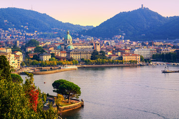 Como city town center on Lake Como, Italy, in warm sunset light
