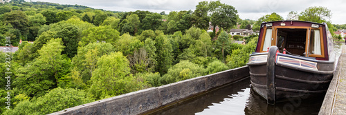 A boat passing the Pontcysyllte Aqueduct (the highest in the world) near Llangol Canvas Print