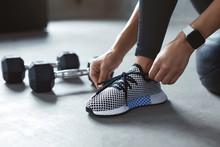 Sports Shoes. Woman Hands Tying Shoelaces On Fashion Sneakers