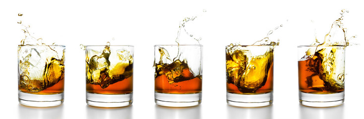 Scotch naočale s viskijem koji prska iz njih