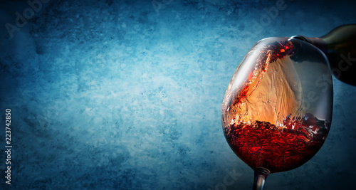 Wine on textured blue