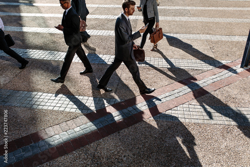 Business people walking to office in the morning on a busy stree - 223747806