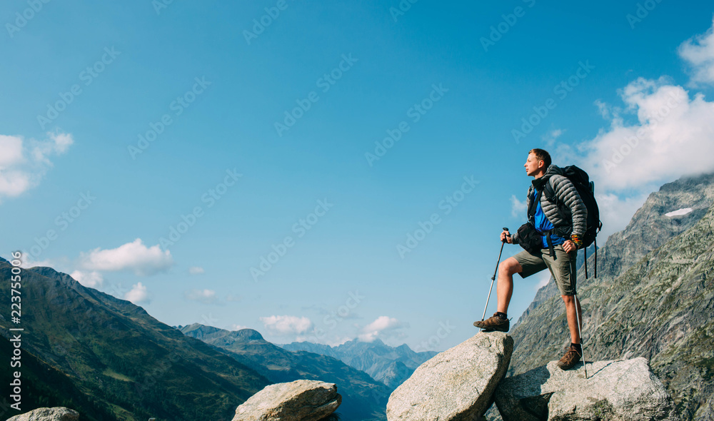Fototapety, obrazy: Hiker man with a backpack, on the mountain peak near pass Grand Ferret . Hiking around Mont Blanc, Switzerland part