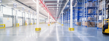 Huge Distribution Warehouse With High Shelves And Loading Gates.
