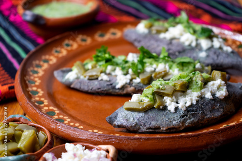 Mexican tlacoyos with green sauce
