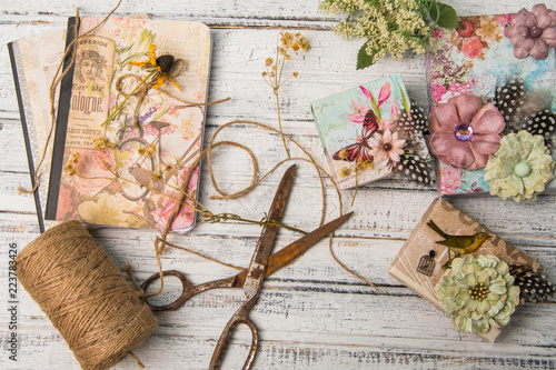 Fotografie, Obraz  Background with decorated gift boxes, roll of jute and vintage scissors