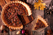 Autumn Pecan Pie, Overhead Table Scene With Cut Slice On A Rustic Wood Background