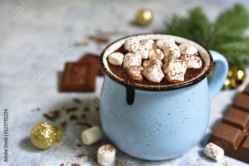 Homemade festive hot chocolate in a blue vintage cup.