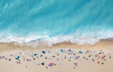 Aerial View At The Beach. Turquoise Water Background From Top View. Summer Seascape From Air. Top View From Drone. Travel Concept And Idea