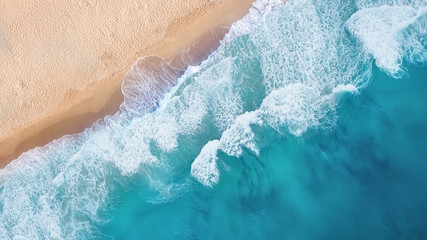 Panel SzklanyBeach and waves from top view. Turquoise water background from top view. Summer seascape from air. Top view from drone. Travel concept and idea