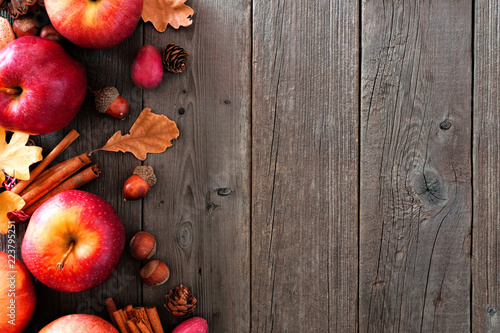 Canvastavla Autumn side border of apples and fall ingredients on a rustic wood background wi