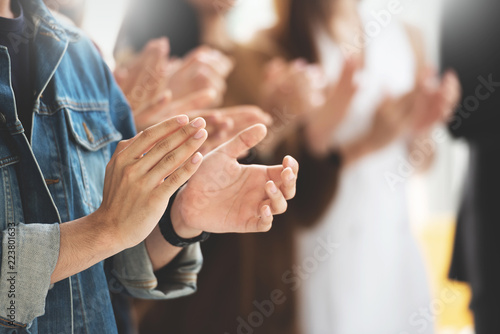 Photo Cropped image of Creative designers audience applauding at a business seminar