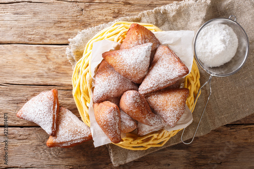 Mandazi, also known as thedaboorSouth Sudanese Coconut Doughnut close-up in a basket. Horizontal top view