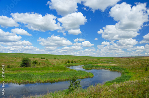 Sunny summer landscape with river curve.Beautiful view of fields,meadows,pastures and woods.Tula region,Russia.