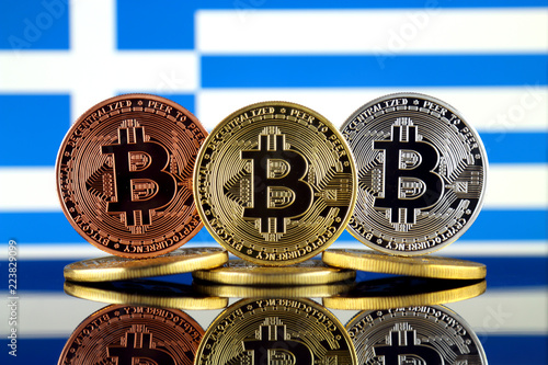 Staande foto Rotterdam Physical version of Bitcoin (BTC) and Greece Flag. Conceptual image for investors in High Technology (Cryptocurrency, Blockchain Technology, Smart Contracts, ICO).