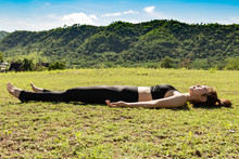 Beautiful Attractive Asian Woman Practice Yoga Dead Body Pose Or Savasana Pose Lying On Green Grass For Yoga Meditation Feeling So Relax And Comfortable,Healthcare Concept