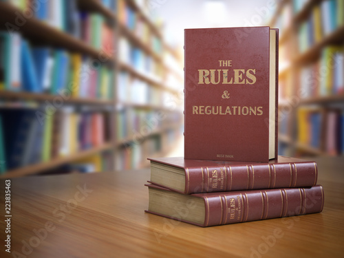 Photo  Rules and regulations books with official instructions and directions of organization or team