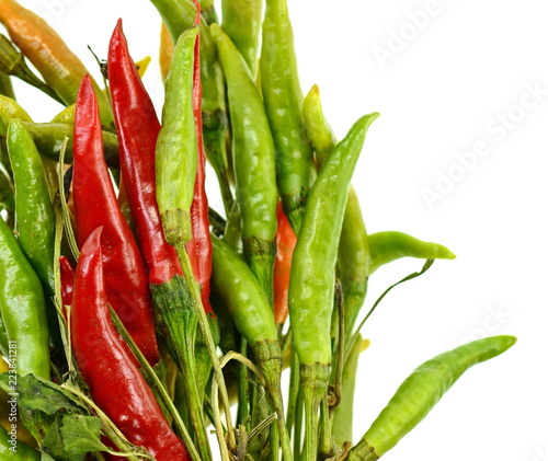 Staande foto Hot chili peppers Green, red and yellow chili pepper isolated on a white background