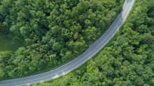 AERIAL TOP DOWN: Cinematic View Of Empty Country Road In Rural Part Of Slovenia.