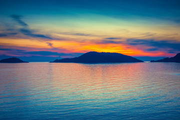 FototapetaBright color sunset over blue sea