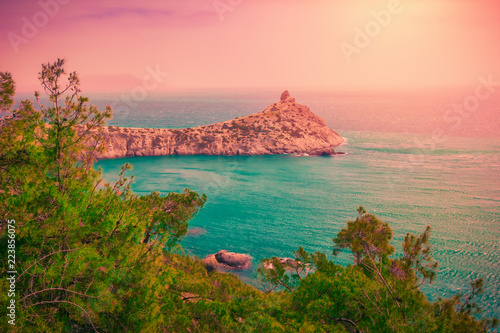 Foto op Aluminium Zalm Scenic sunset seascape with blue sea and mountains