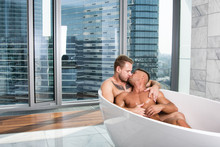 Two Sexy Guys Are Washing In T...