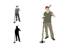 Man Standing With A Detector And A Pickaxe On His Shoulder