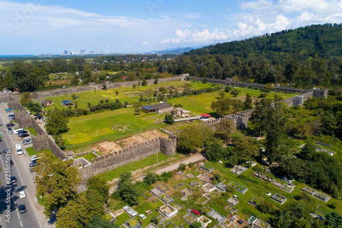 Foto  A view from above of the ruins of the fortress Gonio and the cemetery